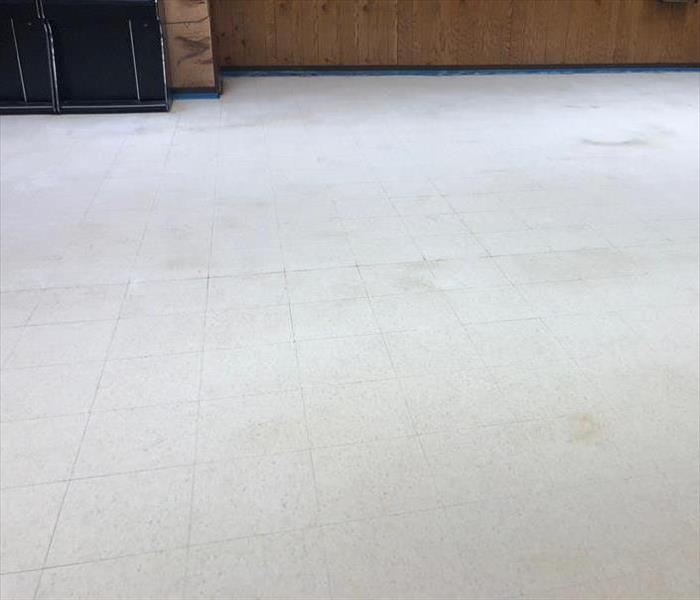 Commercial property floor before stripping and waxing