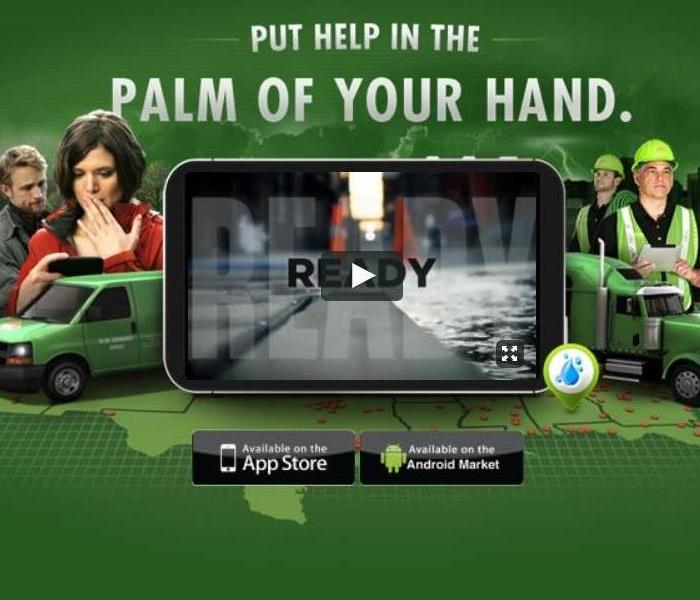 SERVPRO Professionals, fleet, customers and an iPad.
